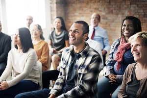 Happy people smiling in a casual meeting