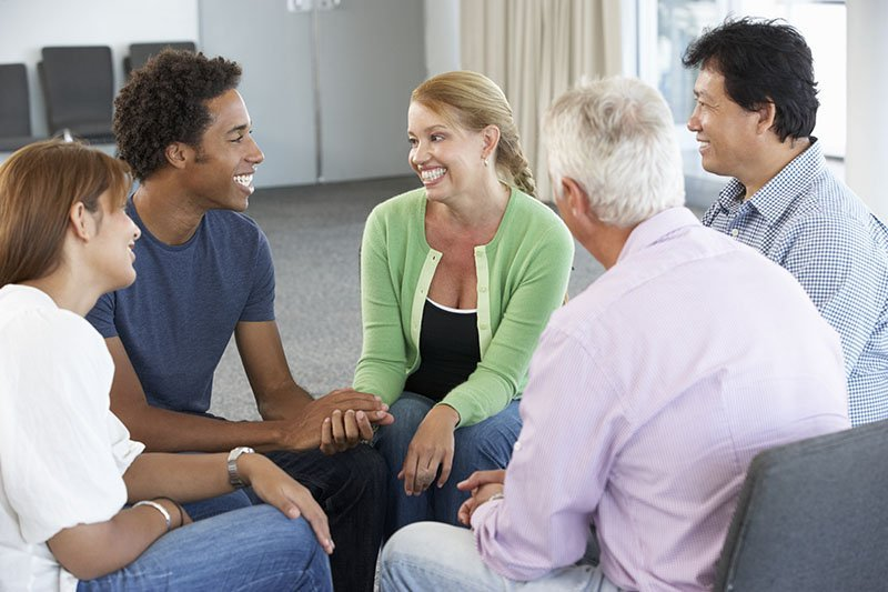 Group of people meeting and talking in a circle